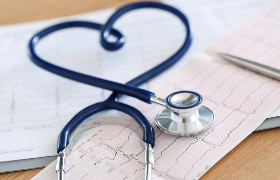 Stethoscope on EKG background