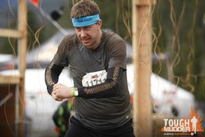 Running through electric wires (and getting shocked!) at the finish of the Tough Mudder!